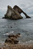 Bow Fiddle Rock quartzite sea arch from pebble beach at Portknockie on the North Sea Atlantic ocean Scotland UK