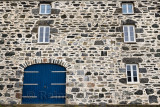 Blue door and windows on stone house at Old Harbourside Portsoy Aberdeenshire Scotland UK