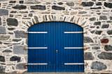Blue door on stone house at Old Harbourside Portsoy Aberdeenshire Scotland UK