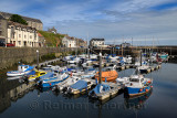 Calm water in the morning at Banff Harbour marina with docked boats and sailboats on Banff Bay Moray Firth Aberdeenshire Scotlan