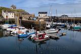 Morning at Banff Harbour marina with docked boats and sailboats on Banff Bay Moray Firth Aberdeenshire Scotland UK