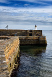 Lighthouse on stone walls of Banff Harbour on Banff Bay Moray Firth Aberdeenshire Scotland UK