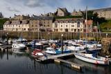 Boats and sailboats docked at Banff Harbour marina on Banff Bay Aberdeenshire Scotland UK