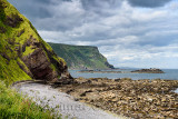Oyster collectors on Gamrie Bay North Sea with sea cliffs at Gardenstown and footpath to Crovie, Banff, Aberdeenshire, Scotland,