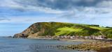 Panorama of single row of houses of Crovie coastal village on Gamrie Bay North Sea Aberdeenshire Scotland UK