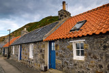 Row of stone houses in coastal fishing village of Crovie Banff Aberdeenshire Scotland UK