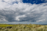 Grass covered sand dunes at Rattray Head on the North Sea at Seatown Buchan Aberdeenshire Scotland UK with Pillbox ruins Old Rat