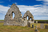 13th Century St Mary Chapel ruins of fieldstone on church grounds with cemetery gravestones at Old Rattray Aberdeenshire Scotlan