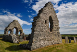 13th Century St Mary Chapel ruins of fieldstone with cemetery gravestones at Old Rattray Aberdeenshire Scotland UK