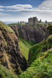Cliffs at Burn of Halymyres stream leading to Donnottar Castle 13th Century ruins near Stonehaven Scotland UK