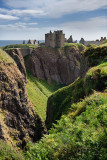 Cliffs at Burn of Halymyres stream leading to Tower House of Donnottar Castle 13th Century ruins near Stonehaven Scotland UK