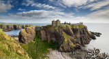 Panorama of Dunnottar Castle Medieval clifftop ruins from cliff above rocks of Old Hall Bay North Sea near Stonehaven Scotland U