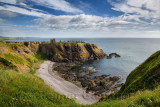 Pebble beach at Old Hall Bay North Sea from clifftop south of Donnottar Castle Medieval fortress ruins near Stonehaven Scotland