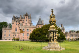 Front lawn of Glamis Castle with wild Ring-necked Pheasant and The Great Sundial with 80 sundials on top and 4 held by Lions Sco