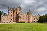 Front lawn of Glamis Castle childhood home of Queen Mother with wild Ring-necked Pheasant with sun and clouds Scotland UK