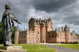 Front lawn of Glamis Castle childhood home of Queen Mother with lead statue of King James I of England and King James VI of Scot