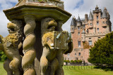 Close up of damaged Lion sculptures of The Great Sundial on the front lawn of Glamis Castle Scotland UK