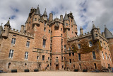 Red stone of the front of Glamis Castle home of the Earl and Countess of Strathmore and Kinghorne Scotland UK