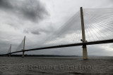 Modern Queensferry Crossing cable stayed suspension bridge over the Firth of Fourth to Edinburgh Scotland UK under stormy gray s