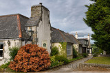 The Lairhillock Inn classic Scottish Inn near Aberdeen Scotland UK with red Lena Scotch broom bush in June