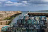Stone St Andrews Pier at Kinness Burn emptying to the North Sea with Lobster traps on Shorehead road St Andrews Fife Scotland UK