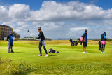 Woman with one arm teeing off on the 18th hole of the Old Course of St Andrews Links the worlds oldest golf course in St Andrews