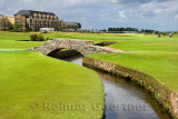 Swilken Bridge over Swilcan Burn on the 18th Hole of the Old Course at St Andrews Links golf course the oldest in the world in S