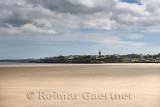 View of St Andrews city skyline from wide West Sands beach used in movie Chariots of Fire on the North Sea Fife Scotland UK
