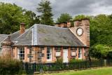West Clock Lodge in Sheriffmoor Plantation Forest at Eagle Lodge Scottish Borders Scotland UK station house with clock on chimne