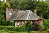 West Clock Lodge coach house in Sheriffmoor Plantation Forest at Eagle Lodge Scottish Borders Scotland UK with ivy and clock chi