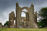 Back of Lindisfarne church ruins of the medieval priory on Holy Island of Lindisfarne Berwick-upon-Tweed England UK