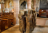 Wood sculpture of monks carrying dead monk in coffin in the nave of The Parish Church of Saint Mary the Virgin on Holy Island of