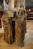 Wood sculpture of monks carrying dead brother in coffin in The Parish Church of Saint Mary the Virgin on Holy Island of Lindisfa