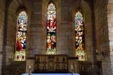 The Parish Church of Saint Mary the Virgin altar with stained glass windows depicting Ascension of Jesus Holy Island of Lindisfa