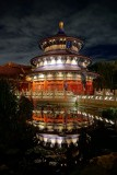 Chinese temple at night with reflecting pond