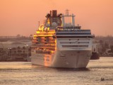 Coral Princess lit by sunset