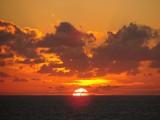 Sun setting on horizon