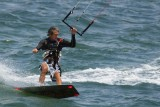 Kite boarder cutting a turn