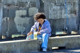 Having A Snack While Fishing On The Sea Wall