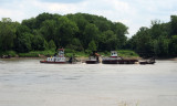 A workboat of some kind with a barge pusher on the Missouri river near St. Louis