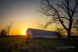 Sunset behind barn