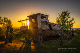 Old fishing boat at sunset