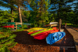 Kayaks and canoes in morning light