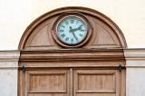 Clock On Wooden Door