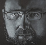 Daniel - white charcoal on black paper, 12 x 12  Won Superior in Siouxland Artist Competition, July 2017