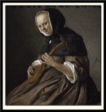 Woman Playing the Cittern, 1662