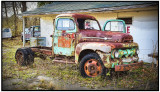 Old Truck in Front of Store