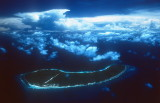 Assumption from the air, Aldabra under the cloud cover in the background.