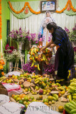 Arranging food on the altar