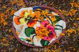 Canasta with marigold petals and confetti